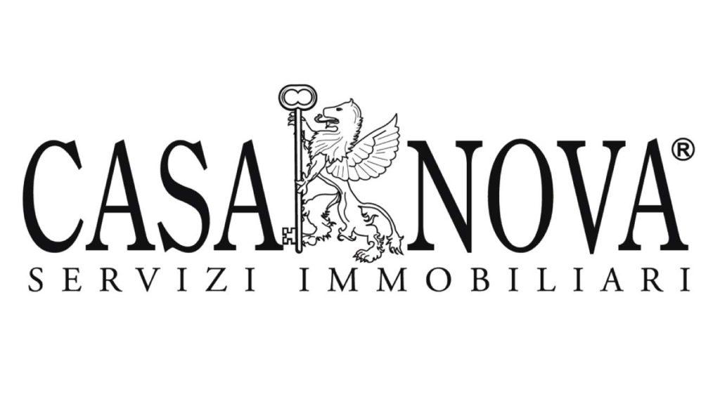 Logo azienda Immobiliare con leone che tiene tra le zampe una chiave